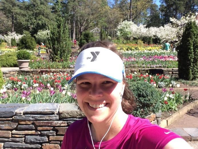 author in white visor smiling